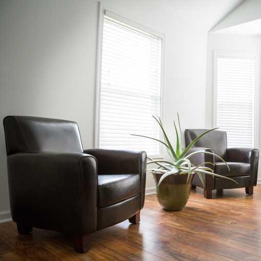 Leather chairs on hardwood floors