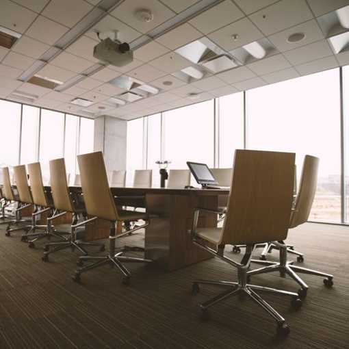 Conference room chairs on commercial carpet