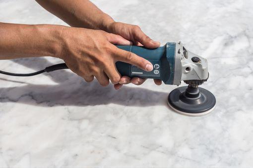 Polishing Marble counter top.