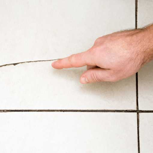 Man Inspecting a tile