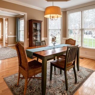 Dining room table on hand woven area rug